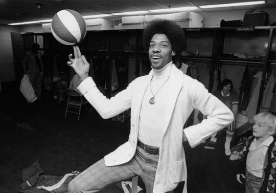 Julius Erving, star forward for the New York Nets, poses prior to a game against the Virginia Squires in Uniondale, NY, on April 8, 1974. Erving, 24, was named the American Basketball Association's Most Valuable Player this season. (AP Photo)