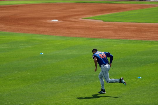 New York Mets pitcher Dellin Betances runs sprints during spring training baseball practice Saturday, Feb. 15, 2020, in Port St. Lucie, Fla.