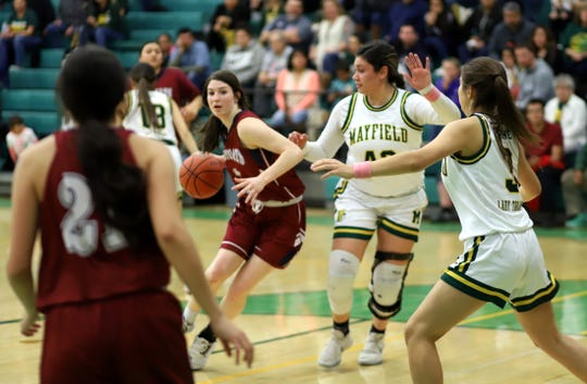 Junior Sierra Manos (with ball) draws a crowd of Mayfield defenders during last week's district semi-final loss.