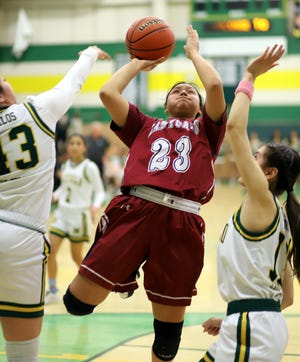 Sophomore Lady 'Cat Harmanie Dominguez (23) is a key ingredient to the success of the Deming High girls' basketball program.