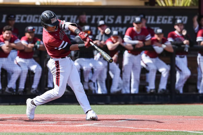 NMSU junior Nick Gonzales takes a swing at the plate as the New Mexico State Men's Baseball team faces off against Purdue Fort Wayne in the first game of a double header at Presley Askew Field in Las Cruces on Saturday, Feb. 29, 2020.