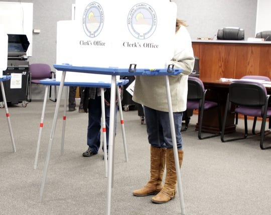 Voters cast ballots, Tuesday, March 3, 2020, in Aztec.
