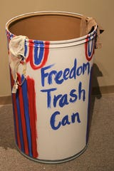 "A Freedom Trash Can adorned with discarded bras and stockings is part of the ""Inside Out"" exhibition at the Farmington Museum at Gateway Park."