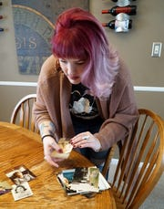 Katie Hardy, founder of Six Feet Over, a suicide prevention outreach program, sorts through some photos of her mother Kathy Simpson at her Livonia home on March 3, 2020. Simpson committed suicide in 2003 and Hardy tries to share her mother's sense of humor and fun when she relates to others who may be struggling with depression.