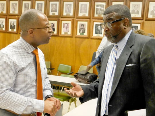 St. Landry Parish School Superintendent Patrick Jenkins discusses the move of students from the Center for Alternative Programs facilitator Randy Pitre (right) following a school board meeting Monday night. The students at CAPS will be relocated next year from their campus on Creswell Lane to make room for a group of students at Opelousas Middle School.