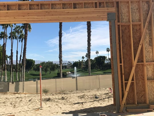 Construction of a new fitness center overlooks the ninth green of the North Course at The