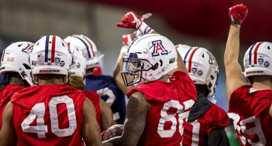 Arizona junior wide receiver Stanley Berryhill III (86) smiles while in a huddle during the team's first spring practice. The Wildcats are coming off a 4-8 season in which they lost their final seven games.
