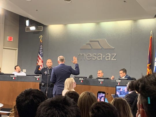 Ken Cost being sworn in as police chief by Mayor John Giles at the March 2 Mesa City Council meeting.