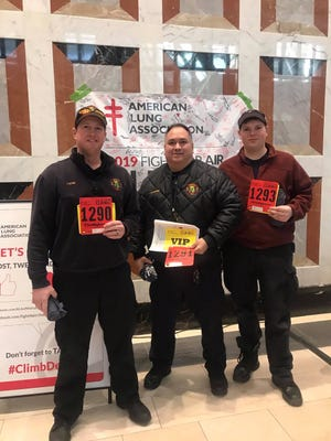 (from left):  Sgt. Chris Rose and firefighters Eduardo Schoen and Jacob Eschenburg participate in the American Lung Association's Fight for Air Climb, raising more than $850 in the fight against lung disease.