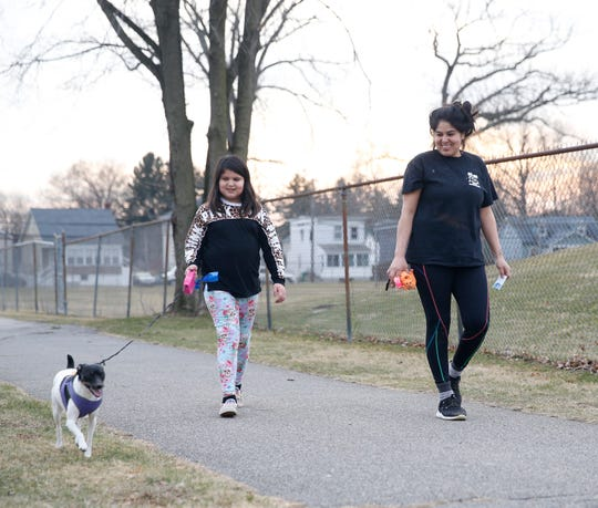 From left, Nicole Cabrejo and Angelica Aguilar walk their dog Macie in Beacon on March 2, 2020.