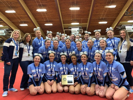 The John Jay cheerleading team, along with coaches Alice Granger, Mary Collier and Danielle Tierney, pose in celebration of their Section 1 championship on Saturday.