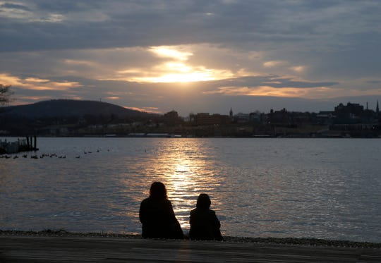 A mother and son enjoy the sunset at Long Dock Park in Beacon on March 2, 2020.