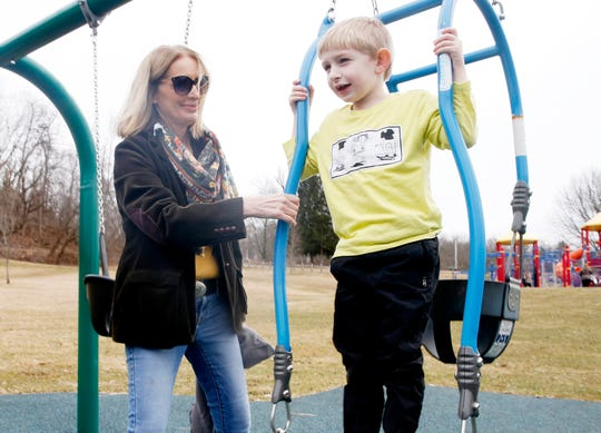 Lorie Ferry pushes her grandson, Max, on a swing at Bowdoin Park on March 3, 2020.