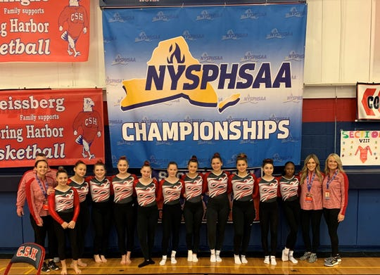 Members of the Section 9 gymnastics team pose after competing in the state championships on Saturday at Cold Spring Harbor High School on Long Island.