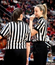 Referee Jenny Horvatinovic talks with another official during Central York's District 3 Class 6-A girls' basketball final against Central Dauphin at the Giant Center Saturday, Feb. 29, 2020. Horvatinovich played basketball at Dallastown and Red Lion during her high school career. Bill Kalina photo