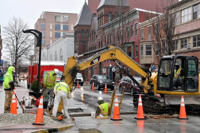 Crews replace water pipe on W. Philadelphia Street at N. Beaver Street, Tuesday, March 3, 2020.John A. Pavoncello photo