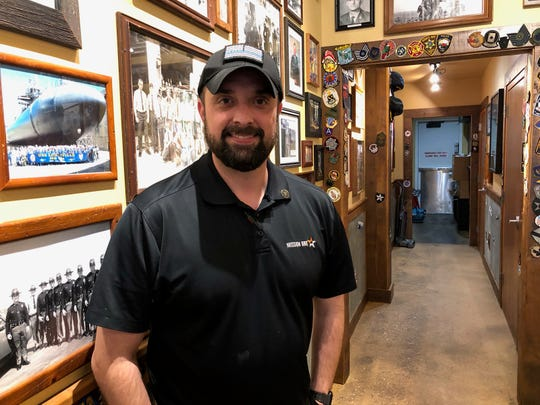 Mission BBQ operating partner Chris McCullough poses Tuesday in the restaurant located at 970 Loucks Road in York City.