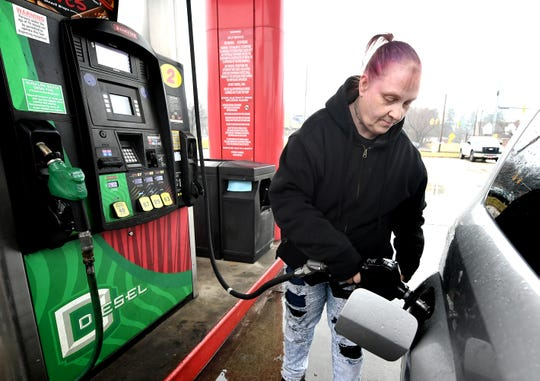 Lauren Rauth of York City gets gas at the Sheetz at 1484 Carlisle Rd. In West Manchester Township Tuesday, March 3, 2020. One of the biggest factors that determines the amount of liquid fuels fund allocations is gas sales, which were down statewide this past year. Bill Kalina photo