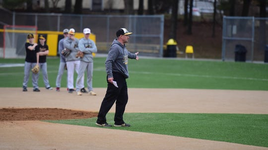 Red Lion baseball coach Kevin Lawrence explains a drill to his players during the first day of spring practice on Monday, March 2, 2020.