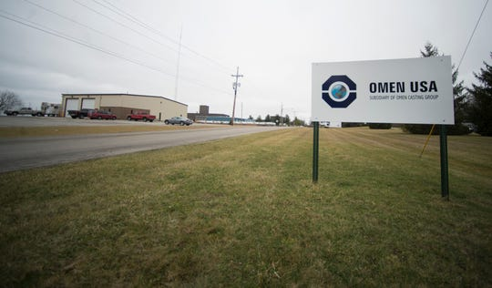 A sign for Omen USA is seen along Rich Road in Richmond.