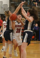 Penfield's Haley Emmick, center, drives between the defense of Mercy's Hannah Chaffer, left, and Katie Whitaker, right.