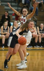 Mercy's Emily Tabone, front, drives the baseline around Penfield's Kennedy Cone.