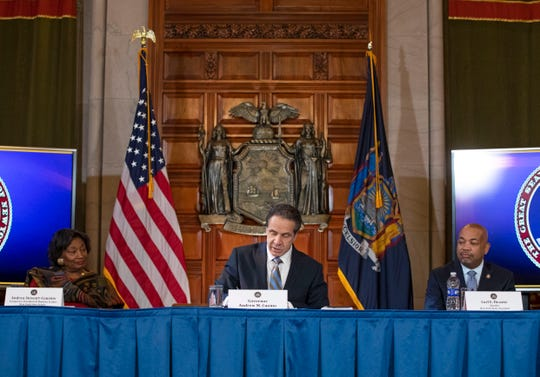 Gov. Andrew M. Cuomo signs coronavirus legislation during a ceremony in the Red Room at the State Capitol on March 3, 2020