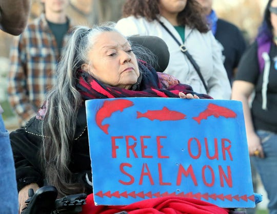 Yurok tribal member and elder Jene L. McCovey holds a sign during a protest against the proposed Delta Conveyance Plan outside the Sheraton Redding Hotel where the state Department of Water Resources held a public meeting Monday evening, March 2, 2020, on the proposal for a new tunnel to transfer water to Southern California.