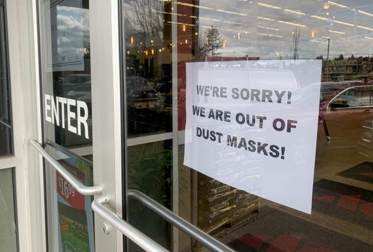 A sign notifying customer they are out of dust masks hangs on the entrance to the ACE Hardware on Madrona Avenue in Salem, March 3, 2020. Medical masks, dust masks, dehydrated food and hand sanitizer are among the many items that customers have purchased since the weekend due to reports of coronavirus in Oregon and Washington.