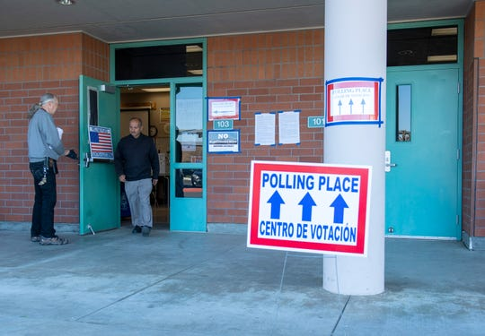 A voter exits a polling place located in La Paz Middle School on March 3, 2020.