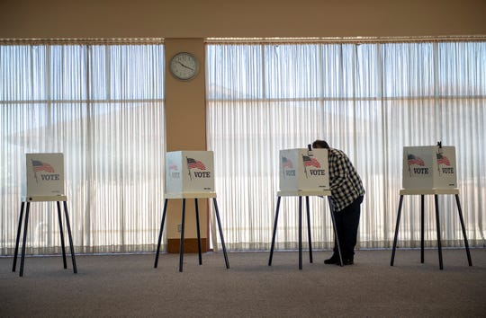Francisco Muniz votes inside the Madonna Del Sasso Parish Hall on Mar. 03, 2020.