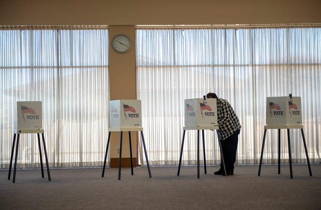 Francisco Muniz votes inside the Madonna Del Sasso Parish Hall on Mar. 03, 2020.