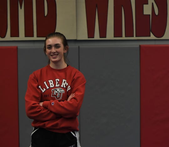 Julia Fitzpatrick is the first girls in James M. Bennett wrestling history to win a regional match.
