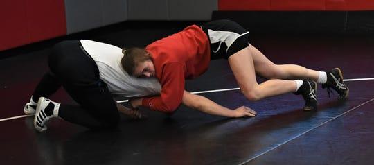James M. Bennett wrestler Julia Fitzpatrick wrestles Troy Gibson at practice on Monday, March 3, 2020.