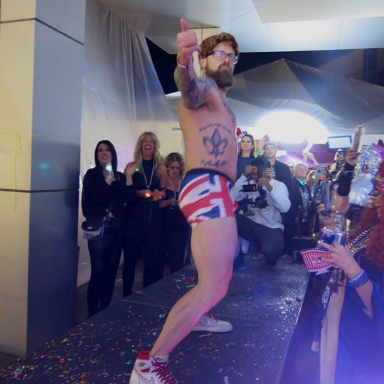 Dillon Hayes pulled a striptease to get into British Flag-inspired  briefs for a ramp  walk and a paparazzi moment at Krewe Highland Grand Bal XXV.