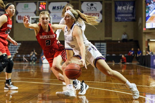 Kaely Hummel of USF drives to the hoop Monday night in the NSIC semifinal against St. Cloud State