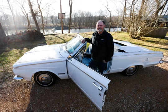 Chuck Applegate with his 1963 Plymouth Valiant 300 convertible.