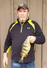Webster County angler Brian Holiday  caught this state-record yellow perch at  Bull Shoals Lake Jan. 27