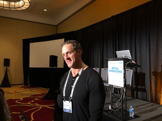 Former NFL player Grant Wistrom talks to fellow sports figures before a panel discussion about medicinal cannabis use among professional athletes at MoCannBizCon+Expo in St. Louis on Tuesday, March 3, 2020.