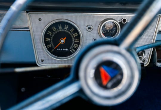 The dash of a 1963 Plymouth Valiant 300 convertible.