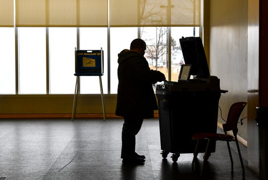 A voter casts a ballot just after noon Tuesday, March 3, 2020, at the St. Cloud Public Library during the Minnesota primary election.