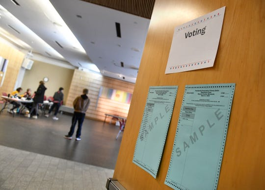 Signs and sample ballots are posted on the doors to the polling place during the Minnesota presidential primary election Tuesday, March 3, 2020, at the St. Cloud Public Library.