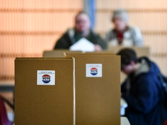 Voters fill out their ballots during the Minnesota presidential primary election Tuesday, March 3, 2020, at the St. Cloud Public Library.