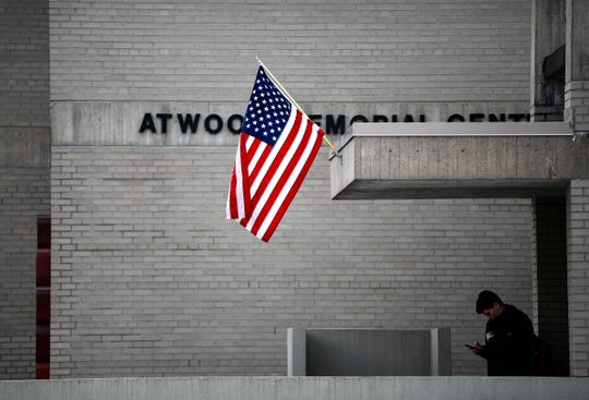 A flag flies near an entrance to Atwood Memorial Center at St. Cloud State University Tuesday, March 3, 2020. Atwood served as a polling place in the Minnesota presidential primary election.