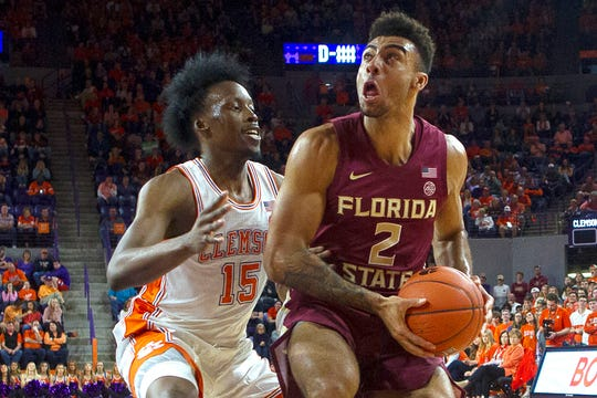 Feb 29, 2020; Clemson, South Carolina, USA; Florida State Seminoles guard Anthony Polite (2) drives to the basket while being defended by Clemson Tigers guard John Newman (15) during the second half at Littlejohn Coliseum. Mandatory Credit: Joshua S. Kelly-USA TODAY Sports