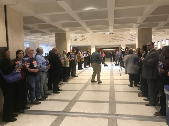 More than 100 union members formed a gauntlet to the doors of the House chambers to protest what they call a union busting bill. HB 1 would require public sector union members to reauthorize their membership on an annual basis