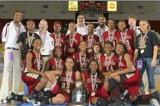 Brittany Christie (No. 22, middle) celebrates winning the 2006-07 3A girls basketball championship after a 46-44 against Parkway.