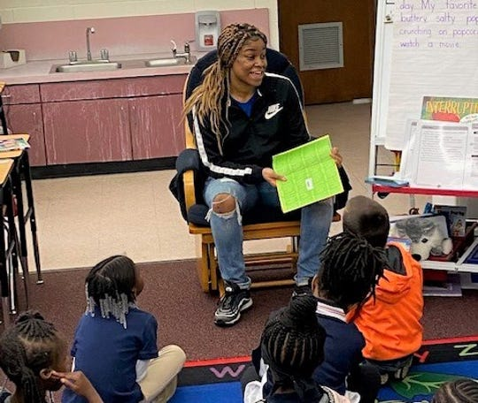 TCC guard Krya Smith speaks with students at Springwood Elementary School during Literacy Week. The partnership between Tallahassee Community College and Brookwood was orchestrated by athletics administrator Brittany Christie.
