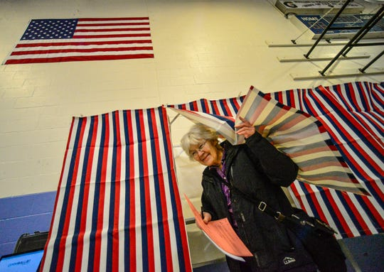 Judy Wingerter exits the voting booth with her ballots for the presidential primary and local election at the Putney Central School, during Super Tuesday on Tuesday, March 3, 2020, Putney, Vermont.