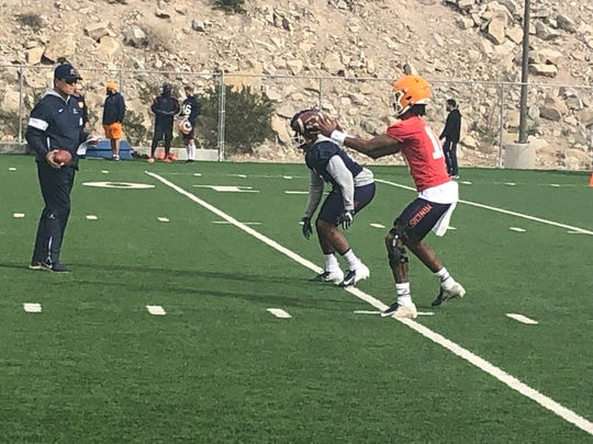 UTEP quarterback TJ Goodwin fields a snap during Tuesday's practice at Glory Field